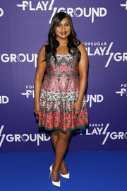 Mindy Kaling contrasted her vibrant dress with simple white pumps by Christian Louboutin.