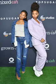 Halle Bailey layered a denim jacket over a loose gray top for the PopSugar x ABC 'Embrace Your Ish' event.