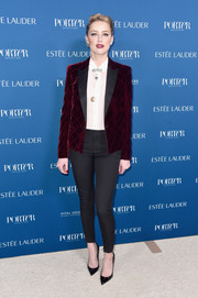 Amber Heard paired her jacket with charcoal cigarette pants.