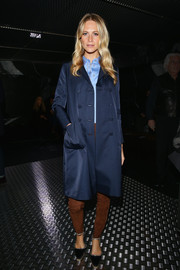 Poppy Delevingne kept it simple in a double-breasted navy coat during the Prada fashion show.