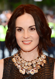 To dress up her bob, Michelle Dockery chose loose piecey waves.