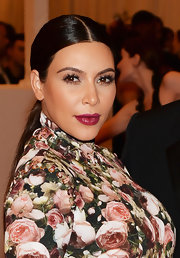 Kim K's berry lip color really stood out beautifully against her olive skin.