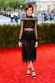 Alexa Chung chose a sheer cutout dress for her rock 'n' roll look at the Met Gala.