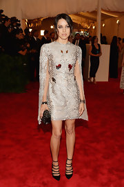 Aubrey Plaza rocked a cape-dress in a slinky silver at the 2013 Met Gala.