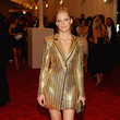 Elizabeth Banks in a Gold Blazer Dress