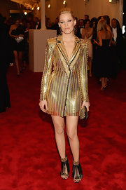 Elizabeth Banks looked totally rock 'n' roll in this gold chainmail jacket at the 2013 Met Gala.