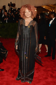 Diane von Furstenberg sparkled on the red carpet at the 2013 Met gala when she wore this floor-length black dress that featured crystal embellishments.