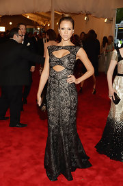 Jessica Alba chose a black leather dress, featuring super sexy cutouts, for her figure-hugging look at the 2013 Met Gala.