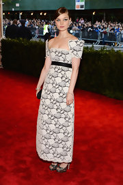 Bella Heathcote chose a white and gray lace dress with structured sleeves for her sweet and feminine look at the 2013 Met Gala.
