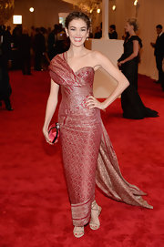 Nora Zehetner showed off just a touch of skin at the 2013 Met Gala, where she wore this one-shoulder red dress that featured a long flowing train.