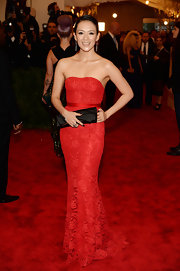 Ziyi Zhang chose this strapless red lace gown for her look at the 2013 Met Gala in NYC.