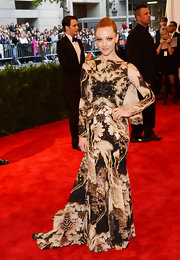 Amanda Seyfried chose a brown and nude print gown with a long draped back and flowing train for her dramatic red carpet look at the 2013 Met Gala.