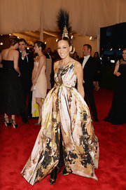 SJP donned this paint-splattered golden, pink, and black gown for a theatrical and chic evening look at the 2013 Met Gala.