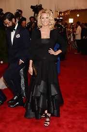 Sandra Lee chose a black tiered evening dress and a matching black blazer for her cool monochromatic look at the Met Gala.