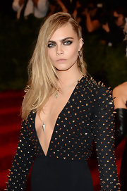 Cara Delevingne chose a deep side part for her punk-inspired red carpet look at the 2013 Met Gala.
