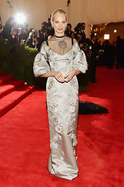 Lauren Santo Domingo chose this silver evening gown with puffed bell sleeves, a mesh neckline and floral embellishments all over for her red carpet look at the 2013 Met Gala.