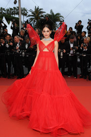 Araya Hargate looked spectacular in a red Jean Paul Gaultier Couture cutout gown with fairy-wing shoulders at the 2019 Cannes Film Festival screening of 'Pain and Glory.'