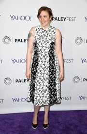 Lena Dunham kept up the monochrome theme with a pair of black Nicholas Kirkwood lace cap-top pumps with low white platforms.