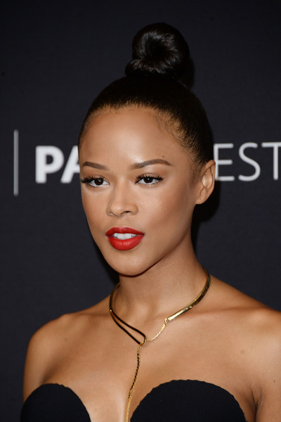 Serayah McNeill polished off her look with a gold lariat necklace by Tara Hirshberg.
