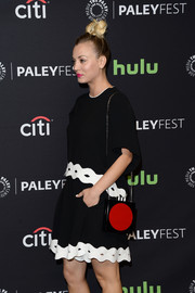 Kaley Cuoco teamed a red and black chain-strap bag with monochrome separates for her PaleyFest Los Angeles look.