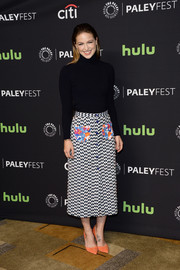 Melissa Benoist styled her sweater with a geometric-print skirt by Tanya Taylor.