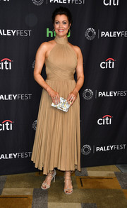 Bellamy Young looked simply divine in a pleated nude halter dress by Maria Lucia Hohan that she paired with rings by Ileana Makri and Randall Scott Fine Jewelry and Sylva & Cie earrings at the 'Scandal' panel during PaleyFest Los Angeles.