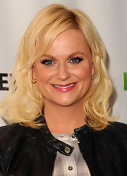 Amy Poehler attended PaleyFest 2012 wearing her hair in wavy layers with long side-swept bangs.
