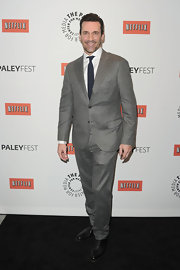 Jon Hamm looked dapper in this heather gray suit with a navy tie at PaleyFest.
