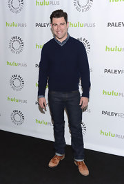 Max Greenfield dressed down his look at PaleyFest 2013 by pairing a v-neck sweater with a button-down and jeans.