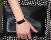 Sarah Paulson paired an over-sized black zip clutch with her print dress for a classic look.