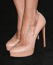 Connie Britton paired basic nude platform pumps with her blue dress for a sophisticated and mature look.