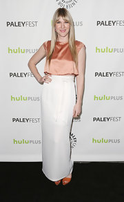 Lily Rabe's long white skirt and peach crop top were an unexpected pairing.