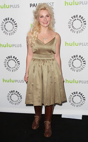 Clare Bowen chose this gold pleated dress for a flirty but country look while attending PaleyFest 2013.
