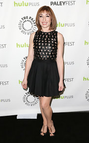 Naomi Grossman's LBD had some modern flare with a full skirt and mod-style cutout bodice.