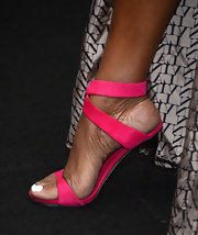NeNe Leakes added a pop of color to her evening look with these hot pink cross-strap sandals.