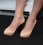 Georgia King kept her heels classic and simple with these nude pumps.