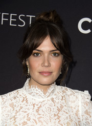 Mandy Moore fixed her hair into a loose top knot with parted bangs for the PaleyFest 2016 Fall TV Preview.