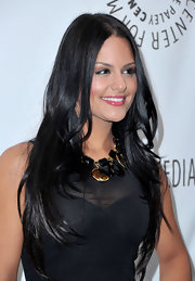 Pia kept her locks sleek and simple with a classic center part.