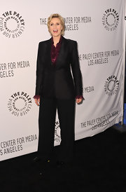 Jane wears a sleek black pantsuit over her maroon silk blouse for her signature style at the 'Glee' fete.