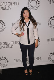 Jenna Ushkowitz balanced her modified menswear attire with a pair of girly black satin platform peep toes.