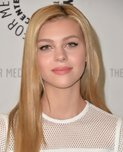 Nicola Peltz's lips looked full and luscious with a soft pink lipstick.