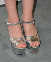 Nicola Peltz chose these super shiny, super high, silver platforms to give her look a funky flare.