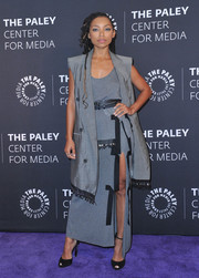 Logan Browning looked cool and chic in a high-slit gray maxi dress by Altuzarra at the Paley Center for Media Presents: An Evening with 'Dear White People.'