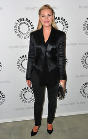 Elisha Cuthbert was chic in an all-black ensemble, including a satin black blazer paired with black skinny pants.