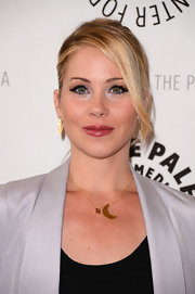 Christina Applegate added a glossy warm pink lipcolor to her sexy look at an evening with  'Up All Night.'