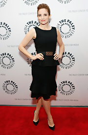 Tina Fey showed her classic style with a black crepe peplum dress and matching belt.