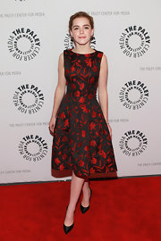 Kiernan Shipka chose a black and red floral, fit-and-flare dress for her super sophisticated look at The Paley Center.