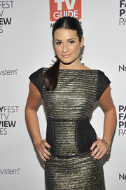 Lea Michele complements her metallic dress with a pair of understated gemstone earrings.