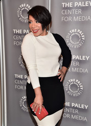 Selenis Leyva's coral box clutch added just the right pop to her monochrome dress at the PaleyLive LA 'Orange is the New Black' event.
