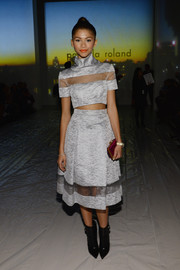 Zendaya Coleman teamed her crop-top with a matching gray sheer-panel skirt.